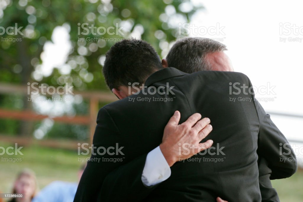 Loving Hug Between Friends / Father and Son stock photo
