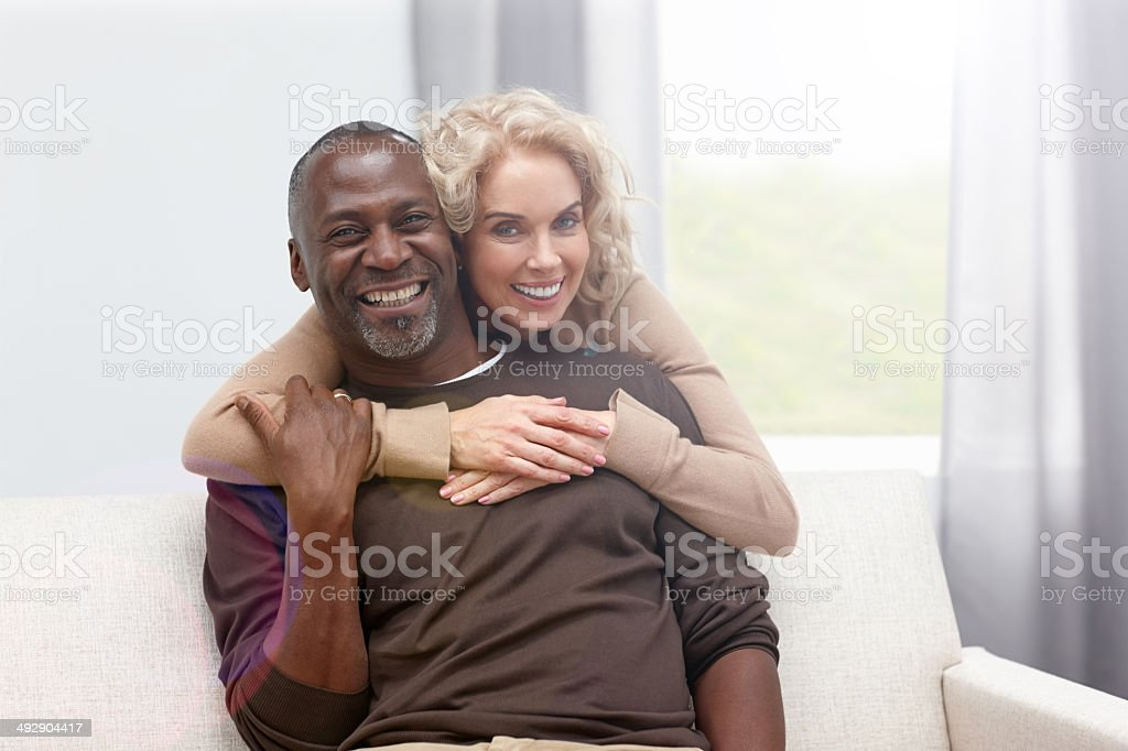 Loving mature couple at home stock photo
