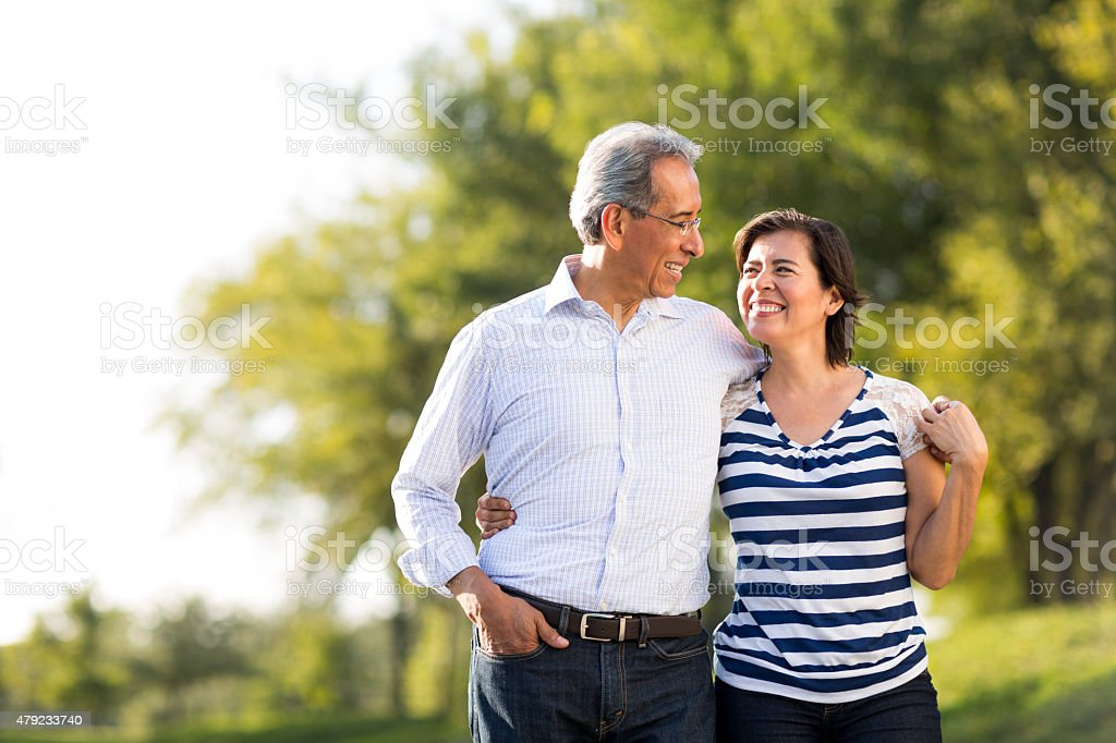 Loving mature couple at walk stock photo