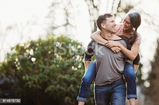 istock Loving Mature Couple Playing Outdoors 914978730