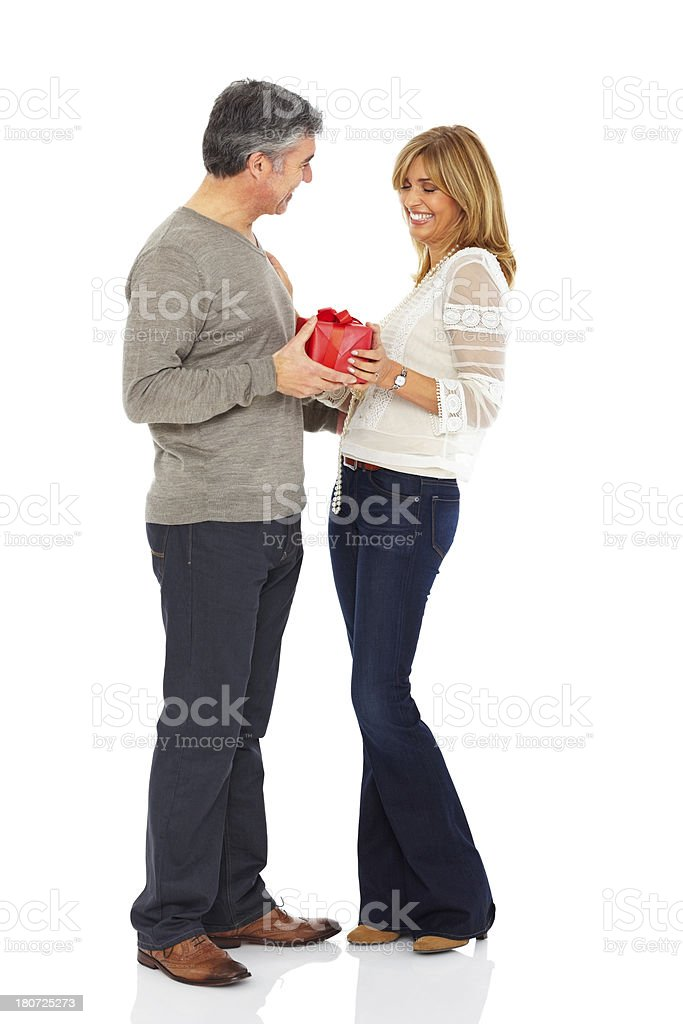 Loving mature man giving a gift box to his wife royalty-free stock photo