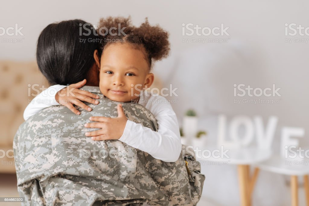 Loving mom returning home to her child stock photo