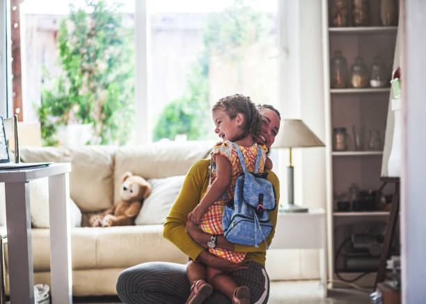 Loving mom sends adorable daughter off to school - foto stock