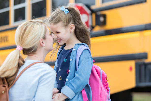 loving mom sends adorable daughter off to school - back to school stock pictures, royalty-free photos & images