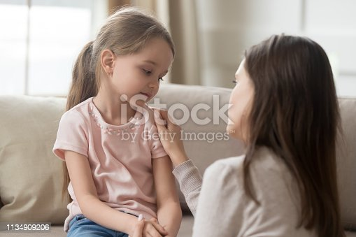 istock Loving mom talking to upset little child girl giving support 1134909206