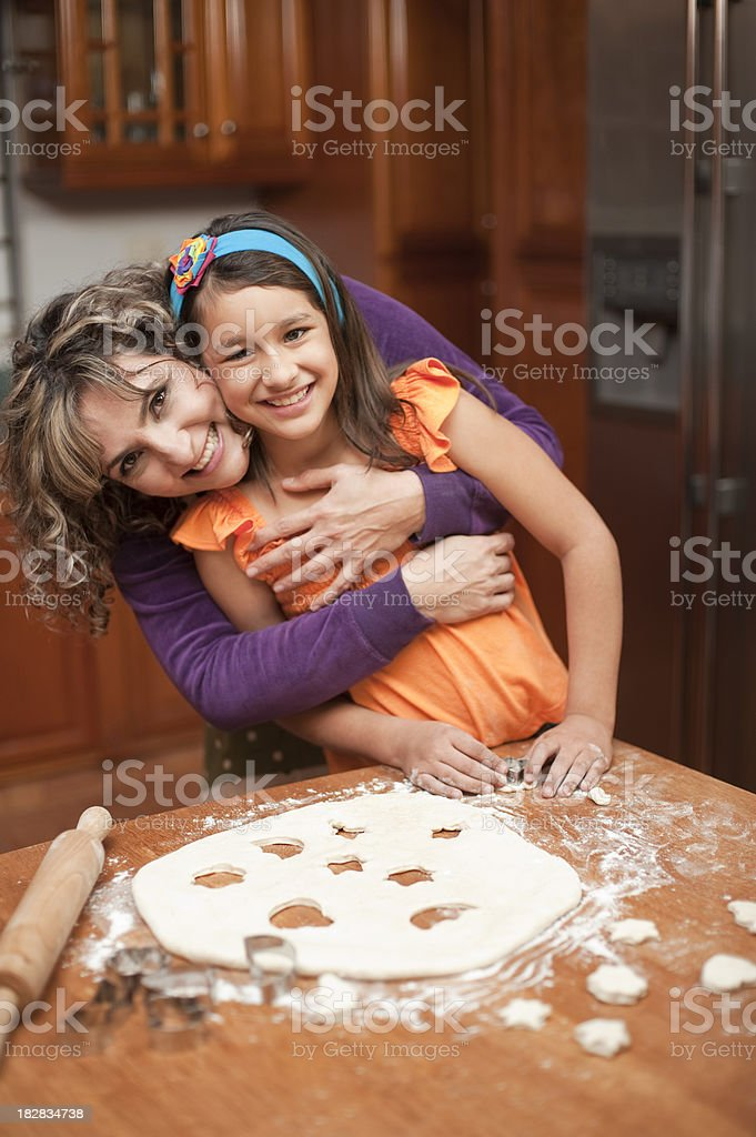 Loving mother and daughter in the kitchen royalty-free stock photo