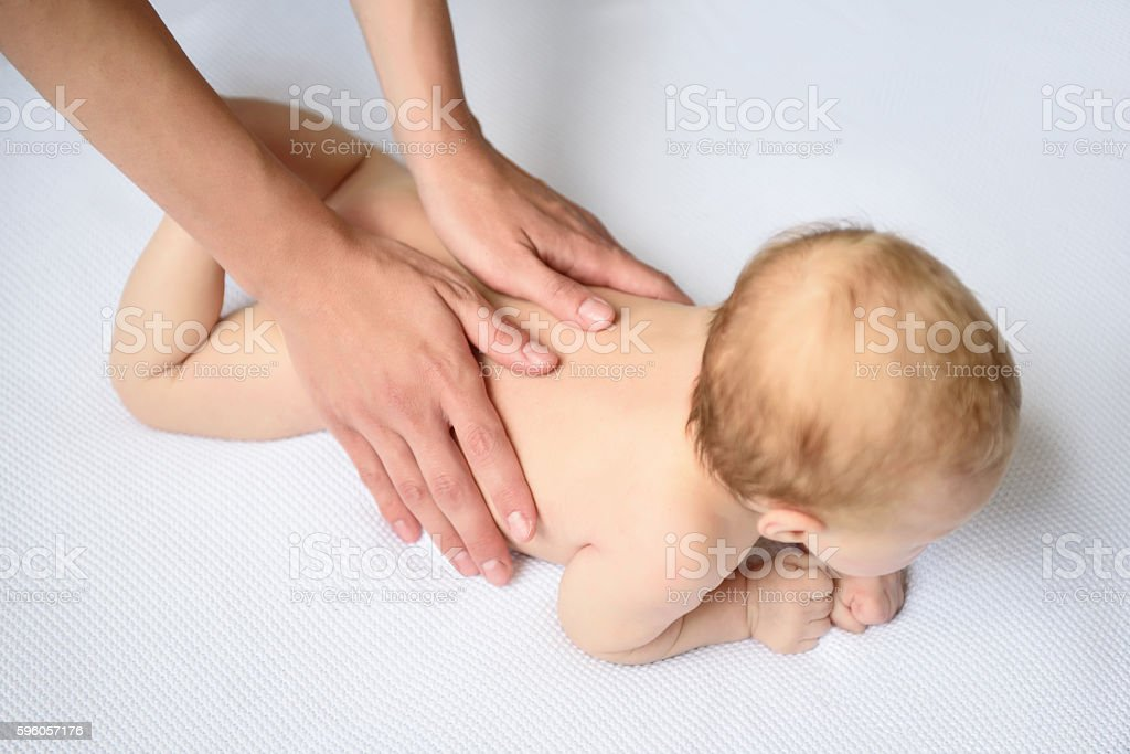 Loving mother caring for her baby girl royalty-free stock photo