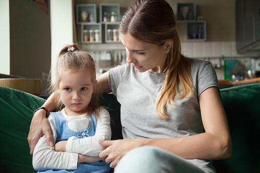 istock Loving mother consoling insulted upset stubborn kid daughter avoiding talk 1028900448