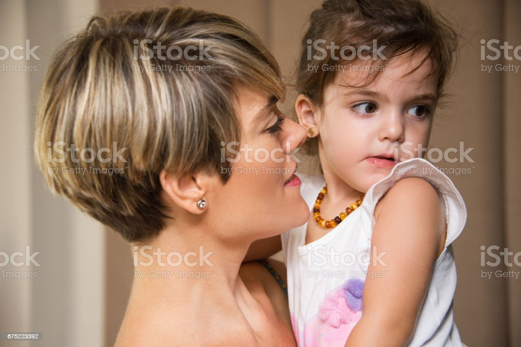 Loving mother looking at adorable daughter royalty-free stock photo