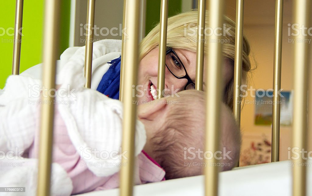 Loving mother smiling at her child in hospital royalty-free stock photo