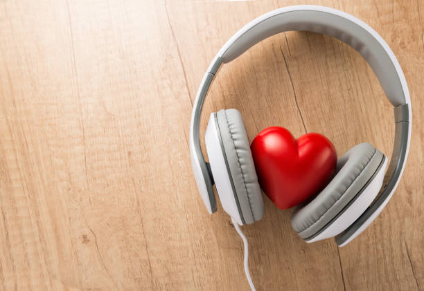 Loving music concept, red heart with headphones stock photo