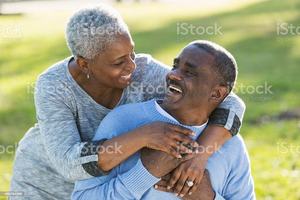 Loving senior African American couple laughing together stock photo