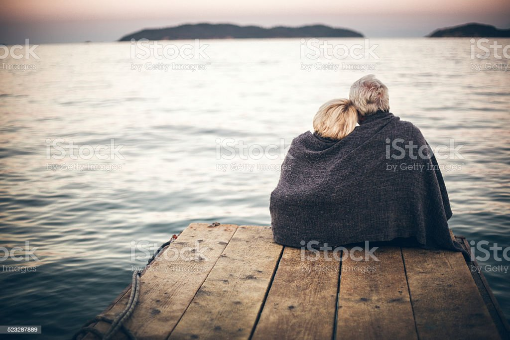 Loving senior couple enjoying the view stock photo