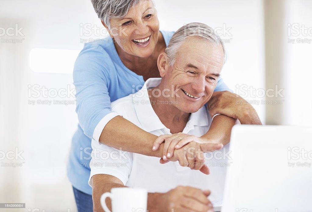 Loving senior couple using laptop royalty-free stock photo