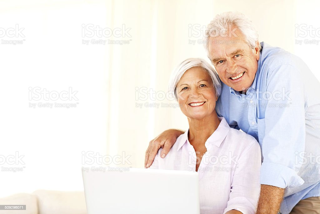Loving Senior Couple With Laptop At Home royalty-free stock photo