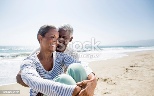 istock Loving senior on the beach 186686872