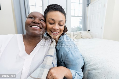 932074776 istock photo Loving senior woman and her adult daughter 958891764