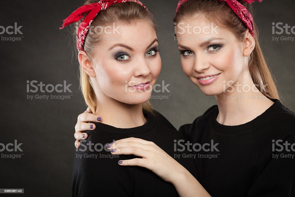 Loving sisters in retro pin up stylization. royalty-free stock photo