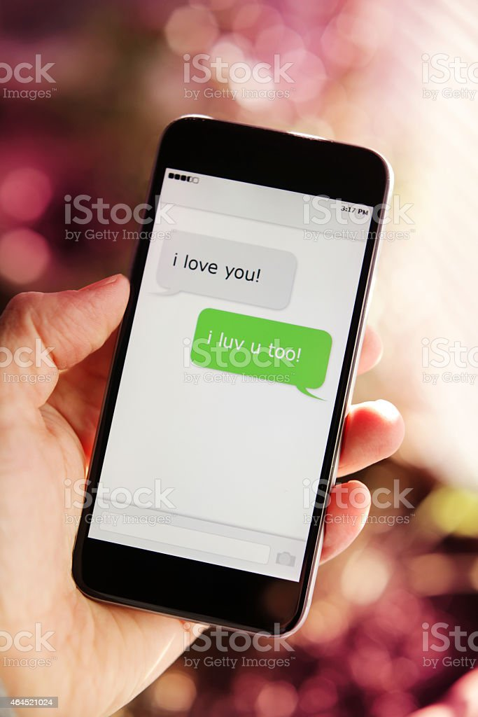 Loving Text Messages on Modern Smartphone stock photo