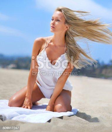 istock Loving the beach breeze 509917247
