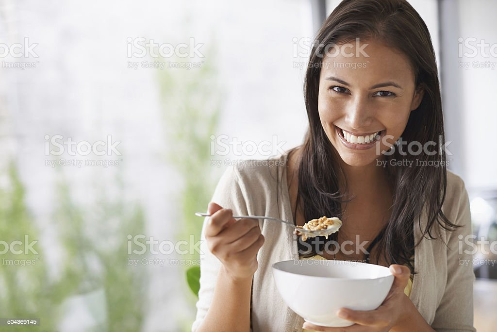 Loving the fresh taste of her morning cereal stock photo