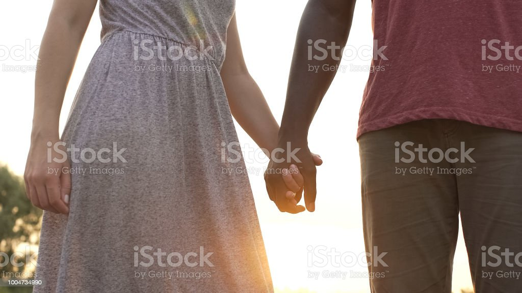 Royalty Free A Man Holding On To A Woman Letting Go Pictures Images