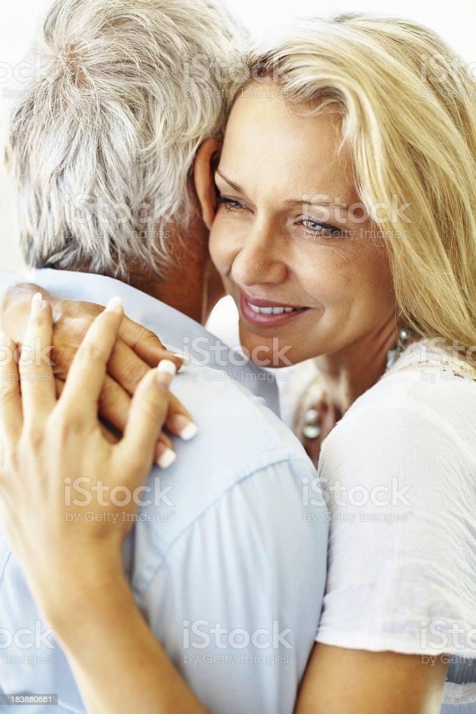 Loving woman hugging a man royalty-free stock photo