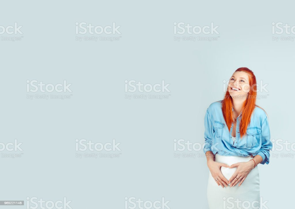 Loving woman in expectancy holding hands on belly royalty-free stock photo