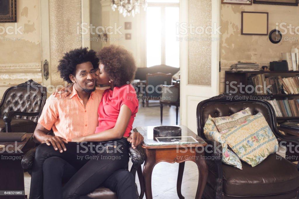 Loving woman kissing man, Havana, Cuba stock photo