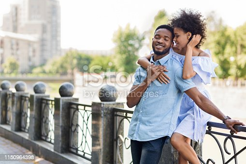 istock Loving young african-american couple embracing on bridge 1150964398
