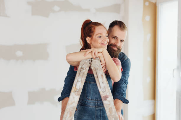 Loving young couple doing DIY home improvements stock photo