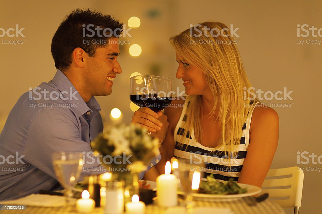 loving young couple enjoying a glass of wine stock photo