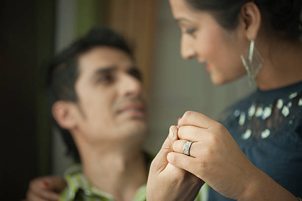 Loving young couple holding hands with engagement ring. – Foto