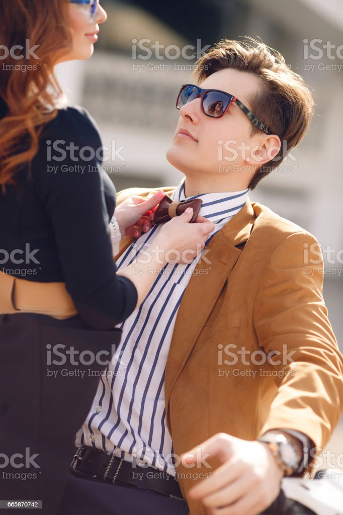 Loving young couple hugging on city street in summer stock photo