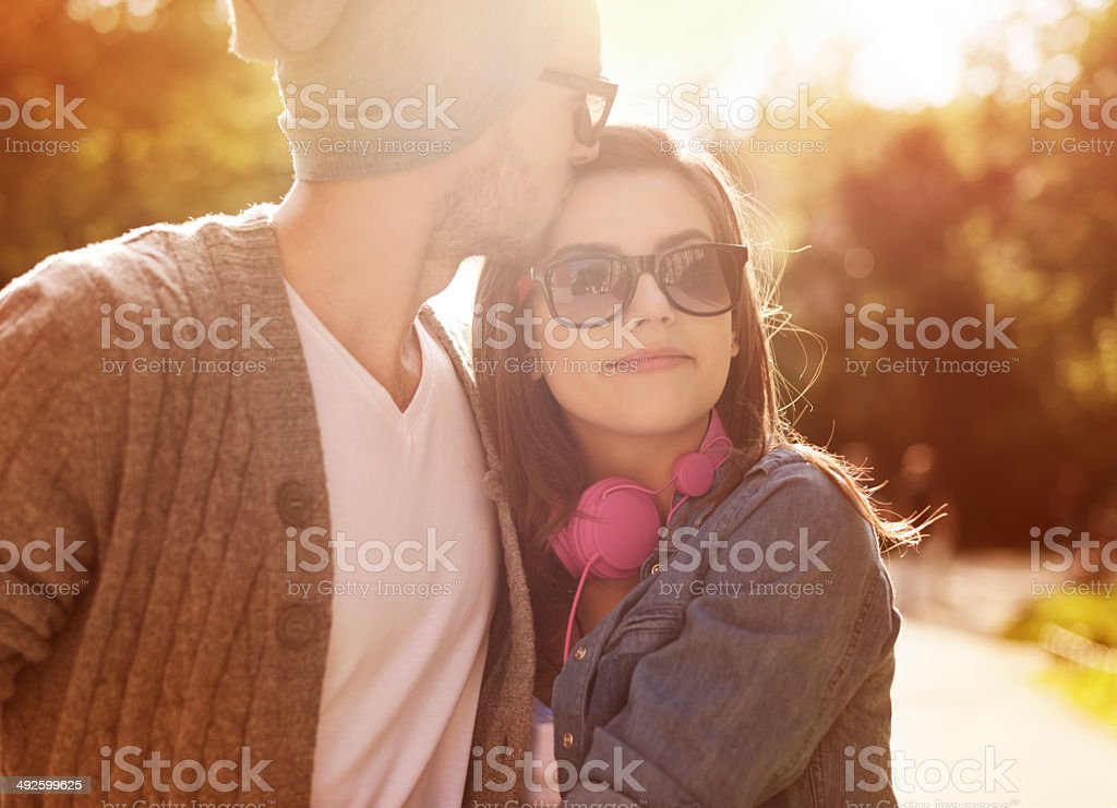 Loving young couple in sunlight stock photo