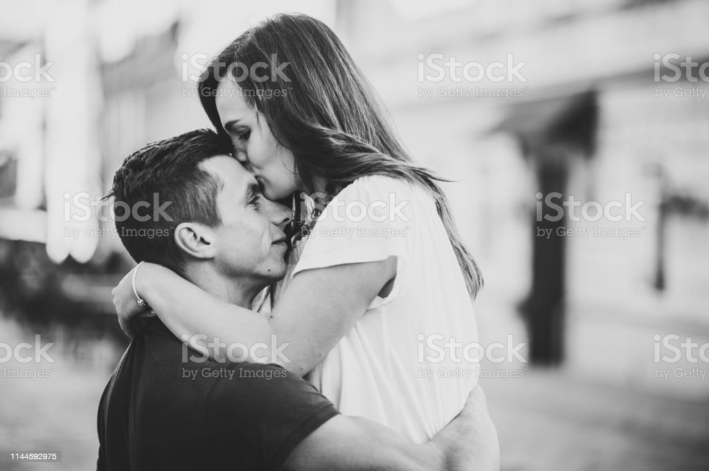 Loving Young Couple Kissing And Hugging In St Valentines Day Outdoors Love And Tenderness Dating Romance Family Anniversary Concept Black And White Photo Stock Photo Download Image Now Istock
