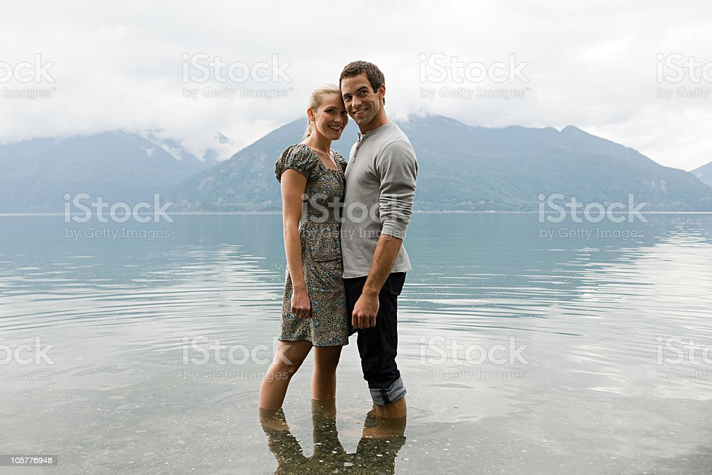 Loving young couple standing in lake royalty-free stock photo