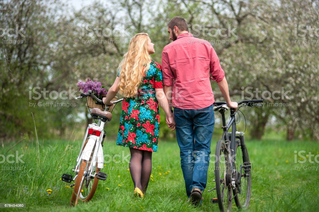 Loving young couple with bicycles royalty-free stock photo