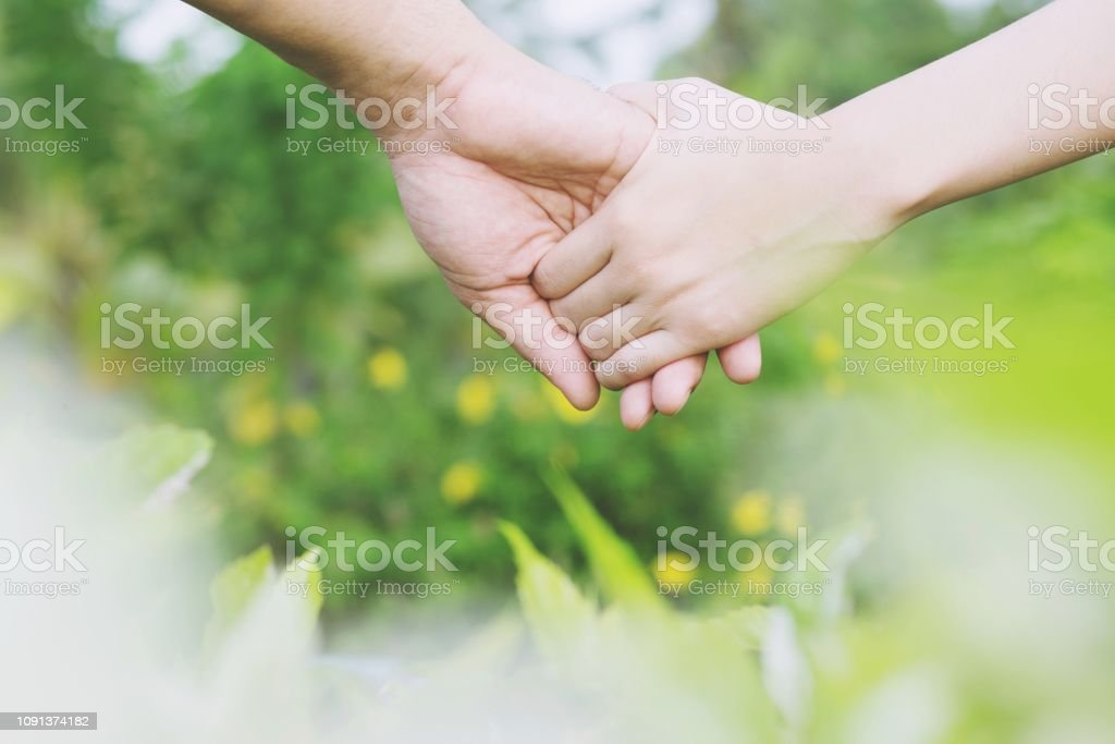 Loving Young love Woman and man holding hand Shake hand together,...