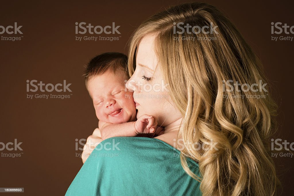Loving Young Mother Kissing Her Newborn Son royalty-free stock photo
