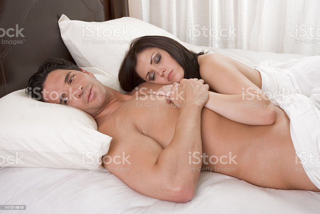 Loving young nude erotic sensual couple in bed royalty-free stock photo