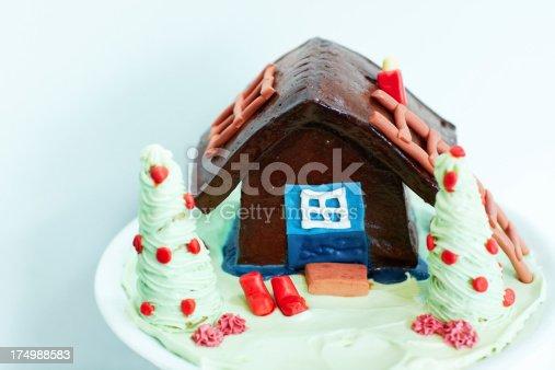 Log cabin-themed ice cream cake isolated on white