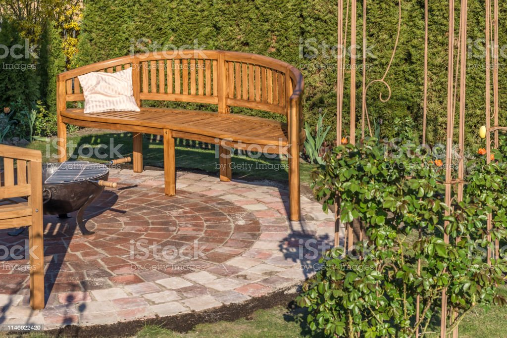 Picture of: Lovingly Designed Garden With Stone Circle Wooden Benches And Fire Bowl Stock Photo Download Image Now Istock