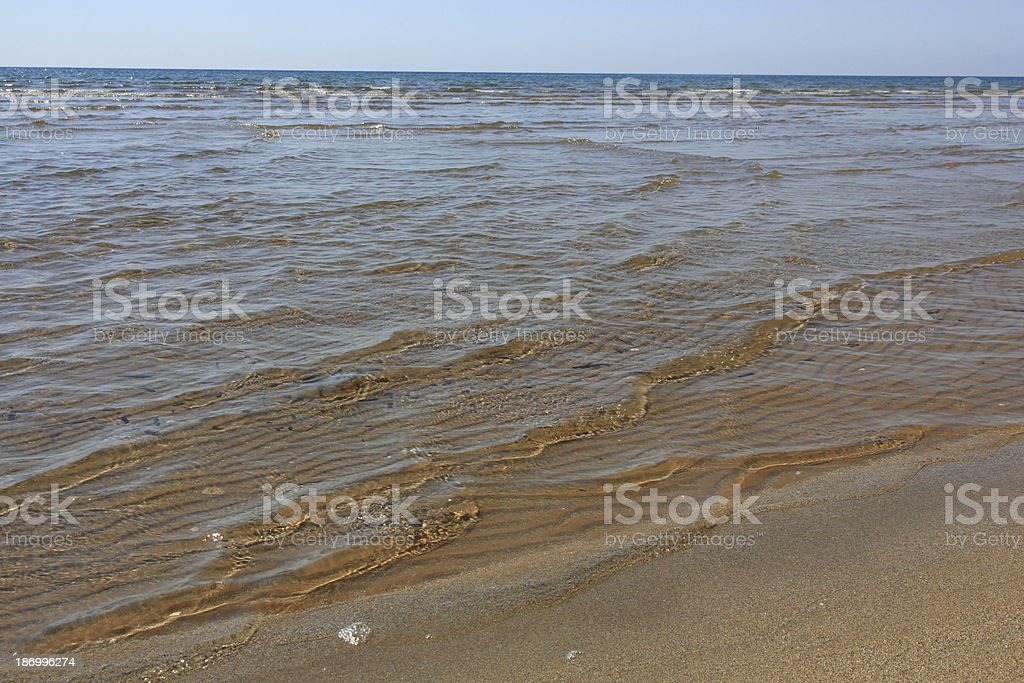 Low and gentle tides on beach royalty-free stock photo
