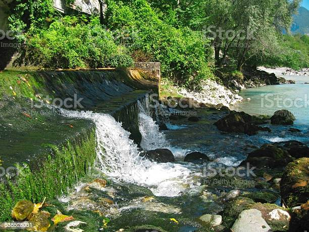 Photo of Low and wide waterfall. Abhazia travel