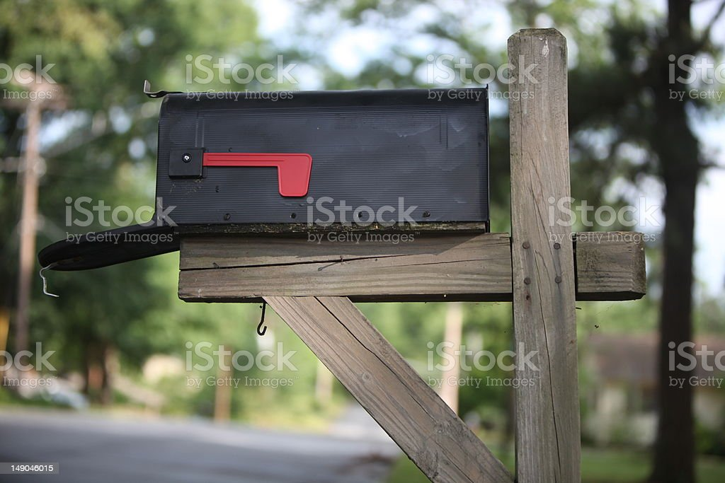 Low angle color image of rural mailbox, door open stock photo