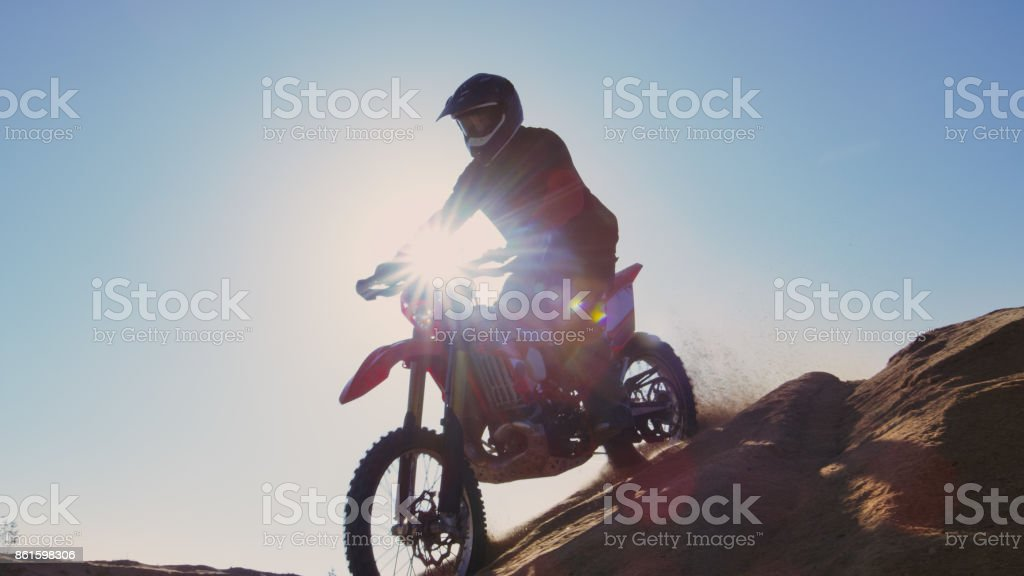 Low Angle Footage of the Professional Motocross Motorcycle Rider...