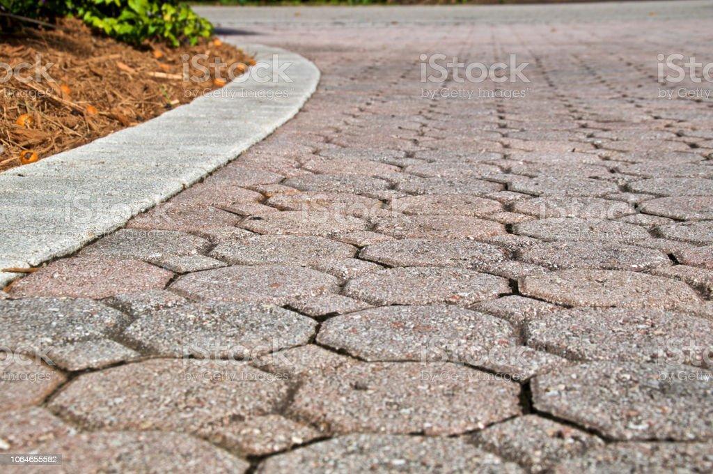 low angle octagon brick paver driveway stock photo