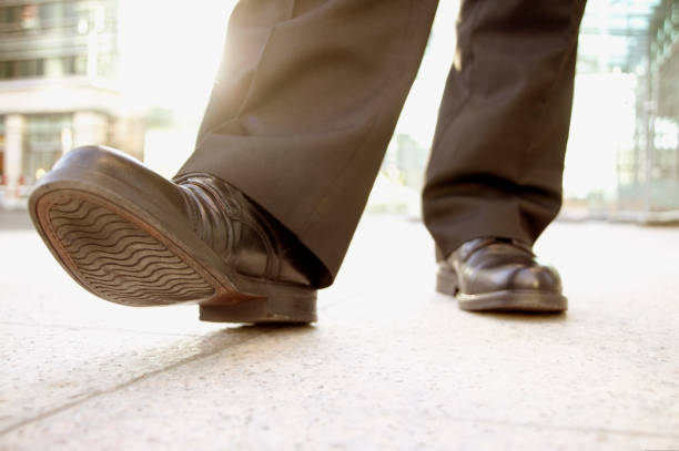 low angle of a businessman shoes - men shoes stock pictures, royalty-free photos & images