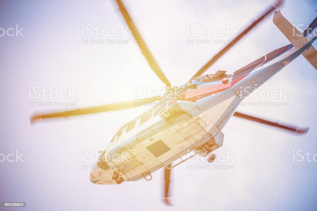 Low Angle of Helicopter Flying in Mid Air stock photo